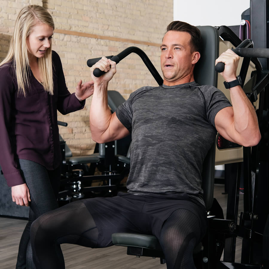 Discover Strength trainer with a client